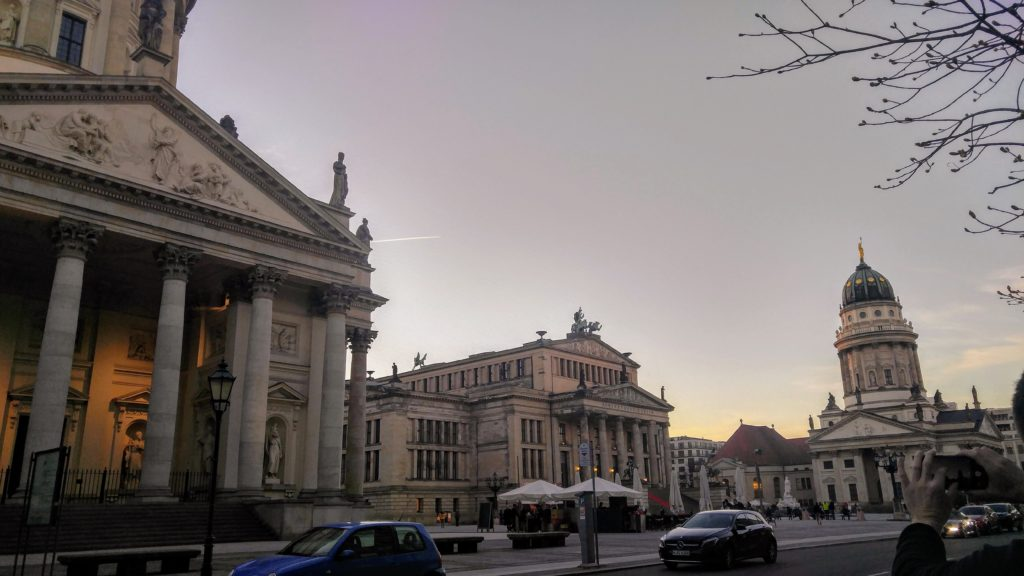 View of the Gendarmenmarkt plaza with the Französischer Dom on the left, the Konzerthaus Berlin in the center, and the Neue Kirche Deutscher Dom on the right.